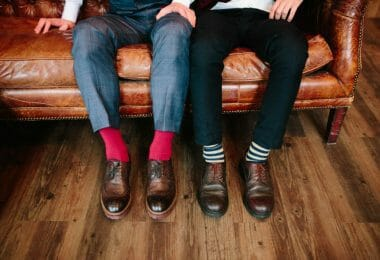Two pairs of men's bamboo socks: red socks and white and blue striped socks